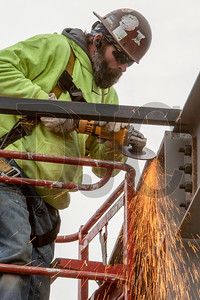 Journeyman ironworker Jim Wright of DSL Builders grinds a fresh weld. (Josh Kulla/DJC)