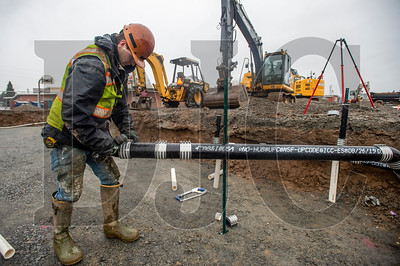 Jed Redinger assembles a wastewater branch line. (Josh Kulla/DJC)