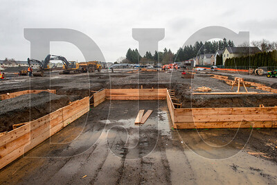 Carpenters with Zavala Corporation are currently constructing formwork for foundation footings. (Josh Kulla/DJC)