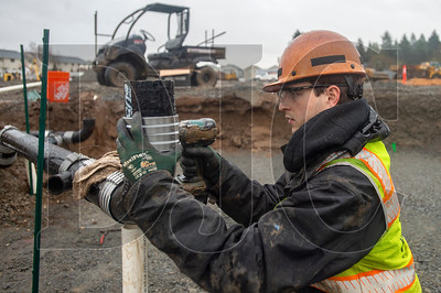 Apprentice plumber Jed Redinger of Piper Mechanical assembles a wastewater branch line. (Josh Kulla/DJC)