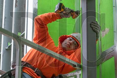 Jose Magaña, an apprentice carpenter with Local 146 and an employee of Fred Shearer & Sons, frames an interior wall at Tigard High School. (Josh Kulla/DJC)