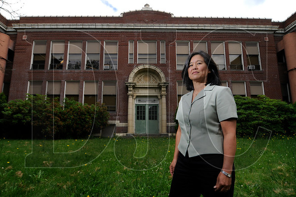 Yumei Wang, a geotechnical engineer and team leader for geo-hazards in the Oregon Department of Geology and Mineral Industries, stands in front of Fernwood Middle School in Northeast Portland.  Wang spearheaded a DOGAMI study which found that many of Portland Public Schools' unreinforced masonry buildings, including Fernwood, would be prone or likely to collapse in the event of a large earthquake.