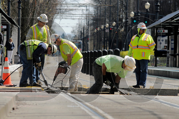 A Stacy and Witbeck crew work on the Portland Streetcar Loop project at the intersection of Northeast Holladay and Seventh streets in Portland's Lloyd District in April.