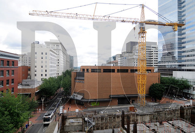 A tower crane at the site of the stalled Park Avenue West project in downtown Portland is the subject of a lawsuit against TMT Development, the firm behind the project.  The owner of the building that houses Nordstrom, Parr Financial, alleges that the crane is trespassing on its property.