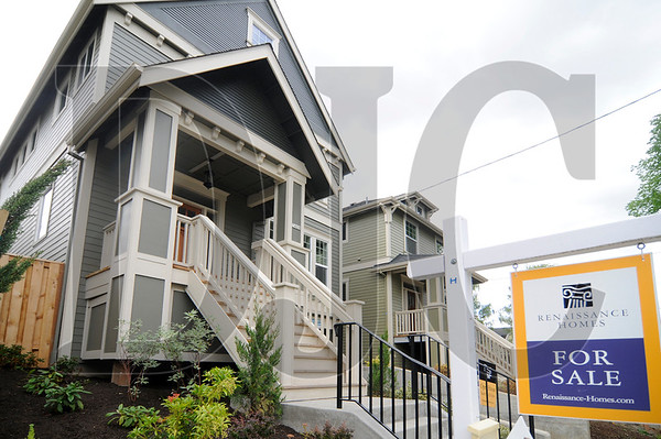 A newly constructed LEED-certified home, left, stands next to another under construction in Southeast Portland on Friday.  According to data released by the Earth Advantage Institute, green-certified homes fetch a significant premium over non-certified homes.