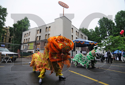 Members of the Northwest Dragon & Lion Dance Association perform at a groundbreaking ceremony for Oregon College of Oriental Medicine's Old Town Chinatown campus on Tuesday, June 28.  Portland-based Beam Development is leading the project, a renovation of the 100-year-old Globe Hotel, with general contractor LCG Pence Construction performing work with design by Ankrom Moisan Associated Architects.