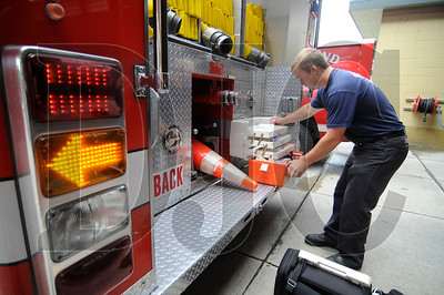 Nick Weichal, a firefighter/paramedic with Portland Fire & Rescue, checks over a medical kit at Fire Station 21 on Thursday.  After issuing an intent to award a contract to rebuild the station to local firm Whelton Architecture, the city has stepped back and is re-considering ten proposals originally submitted for the project.