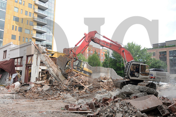Mark Dunham, a superintendent with LOI Demolition Services, clears rubble from the demolition of a building at the corner of Northwest 12th Avenue and Northwest Everett in Portland on Monday, June 20.  The site is the future home of the six-story West Bearing Housing project, which will consist of 50 apartment units over 2,600 square feet of ground floor retail space.
