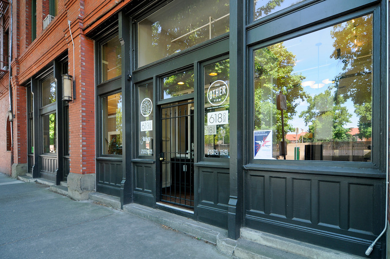 A building at 618 N.W. Glisan St is for sale for $4.5 million. The 40,000-square-foot structure has undergone extensive renovations and currently houses around 16 tenants.