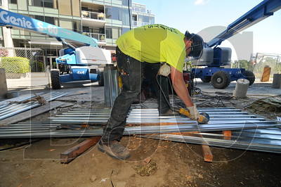 Derick Garcia, a foreman with Buffalo Welding, grinds material for a canopy over the entry of one of the building's retail spaces.