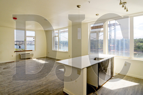 A corner unit on the northeast side of the building features views of the Willamette River and Ross Island Bridge.