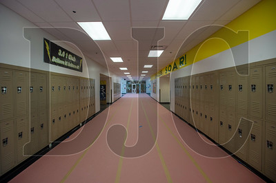 A hallway floor is covered in preparation for removal of ceiling tiles and mechanical systems. (Josh Kulla/DJC)