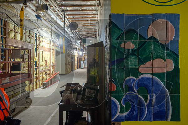 A student-created piece of tile art awaits removal from an interior wall. (Josh Kulla/DJC)