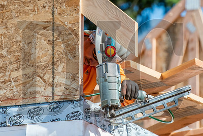 Wood Mechanix carpenter and crew foreman Pedro Guillen-Pacheco secures a gable end truss. (Josh Kulla/DJC)