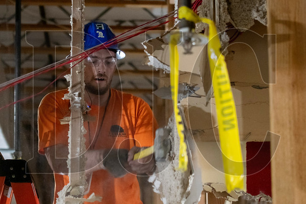 Lester Caba, a laborer and crew foreman with Philco Demolition, demolishes drywall. (Josh Kulla/DJC)