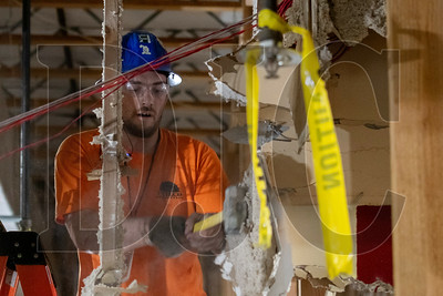 Lester Caba, a laborer and crew foreman with Philco Demolition, demolishes drywall. (Josh Kulla/DJC)