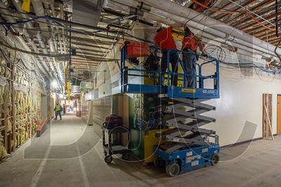 Journeyman electricians Bill Elliott, left, and Paul Deemie, both employees of IES Commercial and Industrial, hang brackets for electrical conduit. (Josh Kulla/DJC)