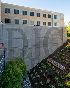 A reinforced concrete wall was re-engineered mid-project to allow rerouting of electrical conduit away from its original position in order to accomodate new shear walls. (Josh Kulla/DJC)