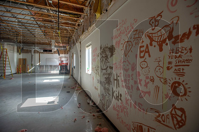 Student art adorns a cafeteria wall, which is being demolished as part of the remodel project. (Josh Kulla/DJC)