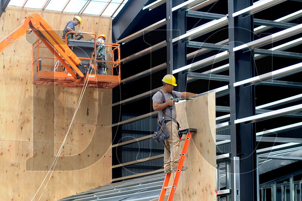 Luis Cagetano, center, of Truss T Built, works on framing the Mt. Angel Community Center on Tuesday.  Ground was broken on the project in early March, with expected completion by the start of the Oktoberfest in September.
