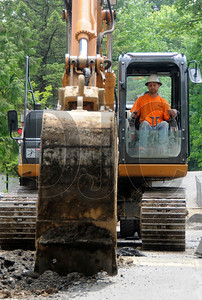 Matt Kost, a heavy equipment operator with M&M Construction Services, excavates for storm and sewer lines at the site of a new dormitory building project at Lewis & Clark College in Southwest Portland on Monday.  The dormitory is being built by general contractor Walsh Construction, and is due to be completed in July of 2012.
