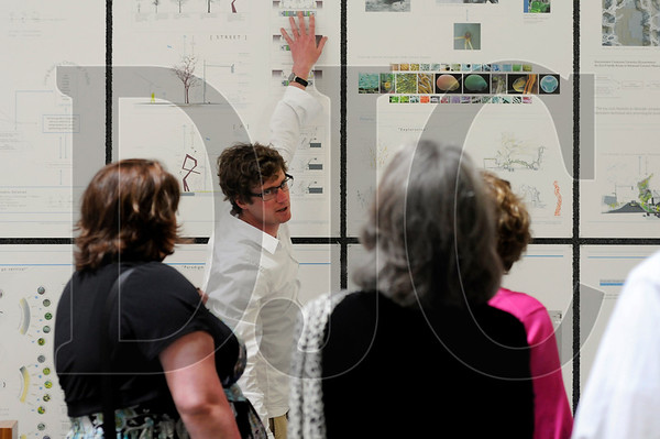 Portland State University architecture student Kyle Norman speaks to family members about his graduate thesis project at the AIA Center for Architecture in Portland on Friday.  Norman was one of 13 students to graduate with the inaugural class of the school's Master of Architecture program.