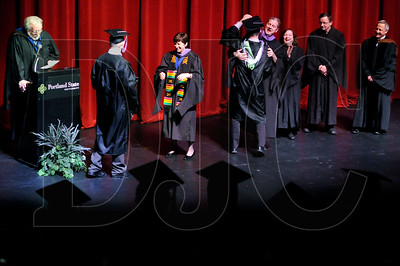 Portland State University Department of Architecture Chair Clive Knights, fifth from left, embraces a graduate of the school's Master of Architecture program during a hooding ceremony for PSU's School of Fine and Performing Arts on Friday.