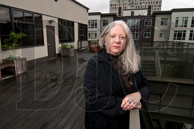Sandra Walden, president and owner of renewable energy development firm Real Energy Solutions, stands on a patio at the Ecotrust building, a project she helped develop which benefitted from Oregon's Business Energy Tax Credit, in Portland on Tuesday.