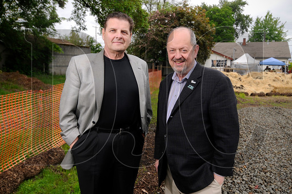Beaverton Community Development Director Don Mazziotti, left, and Mayor Denny Doyle stand on Tuesday at the site of a three-parcel lot that is being earmarked for redevelopment into workforce housing.