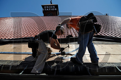 P&C Construction employees and members of Carpenters Local 156 Dave Van Vleck, left, a journeyman carpenter, and Mike Fry, an apprentice carpenter, install seismic strapping to the roof of Union Station in Portland on Friday.