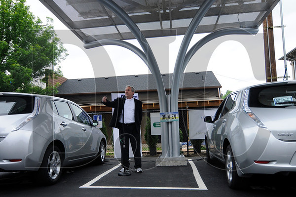 Chad Biasi, co-founder of EV4Oregon, speaks during the opening ceremony for an electric vehicle charging station in Northeast Portland on Wednesday.  The station is located on a public parking lot owned by the Portland Development Commission and features a solar canopy that is tied into the grid.