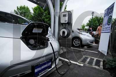 A pair of electric vehicles receive a charge at a new public charging station in a PDC-owned parking lot on Northeast Martin Luther King Jr. Boulevard on Wednesday.  The charging station is the second of its kind in Portland to feature a solar canopy that is tied to the electrical grid.