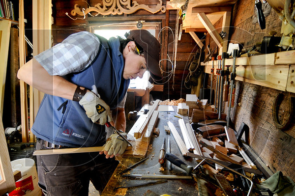Amy McCauley, owner of Oculus Fine Carpentry, fine tunes a mortise and tenon joint while working on a window in her Southeast Portland workshop Wednesday afternoon.