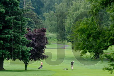 Rachel Hodge, left, watches as her father, Ken, hits a shot on the third fairway of Colwood National Golf Course in Northeast Portland Monday.