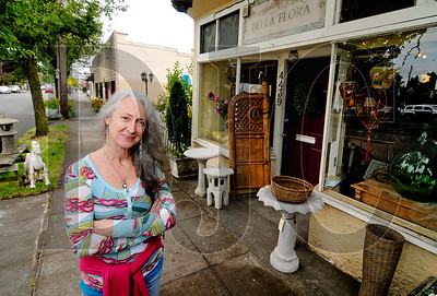Elaine Falbo is the owner of Bella Flora Studio, a 15-year-old vintage shop in the Beaumont-Wilshire neighborhood of Northeast Portland. Falbo and other neighborhood business owners and residents are upset about plans to raze several commercial buildings, including that which houses Bella Flora, to build a 68-unit apartment complex.