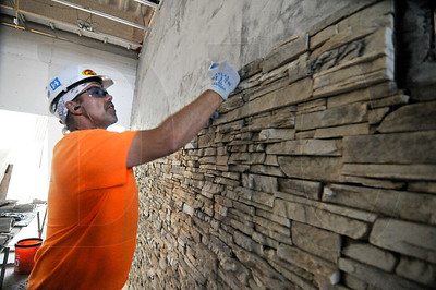 Tom Swearingen, a site foreman with Fredinburg Masonry, Inc., installs architectural stone in a lobby at Villasport Athletic Club and Spa in Beaverton.