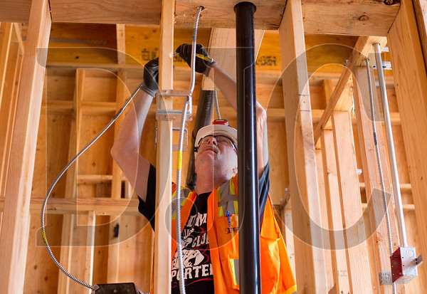 Wendell Morris, an electrician with Team Electric and a journeyman with Local 48, roughs in electrical conduit.