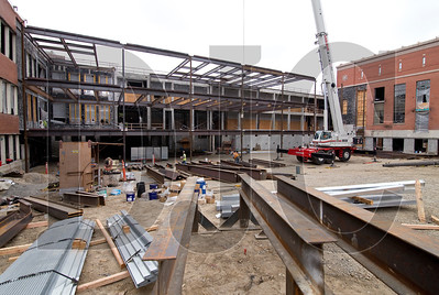 The steel-framed expansion extends about 50 feet from the west side of the existing main building.
