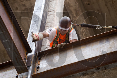 Journeyman ironworker Andre Silvery, a member of Local 29 and employee of Raimore Construction, connects a beam to a column.