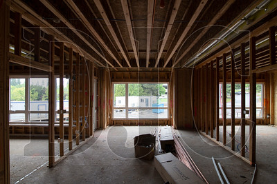 Residential units are in various phases of completion, with some still in the rough-in phase while others are underoging finish work. (Sam Tenney/DJC)