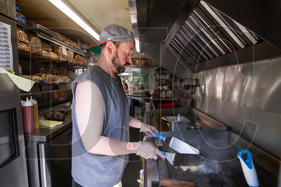 Grilled Cheese Grill owner Matt Breslow works the grill at his food cart on the Block 216 site in downtown Portland. Cart owners were notified Thursday that they must vacate the property by June 30. (Sam Tenney/DJC)