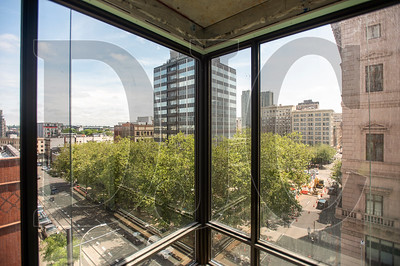 Floor-to-ceiling glazing on a room at the building's northeast corner provides expansive views of the city. (Josh Kulla/DJC)