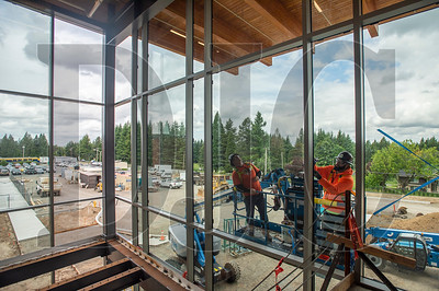 Union glaziers with Benson Industries secure framing for the two-story curtainwall that adorns the front entrance of Sam Barlow High School. (Josh Kulla/DJC)