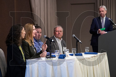 Molly Rogers, second from left, speaks during a panel discussion about affordable housing in the Portland-metro area. The event also featured, from left, co-panelists Emily Lieb, Ben Sturtz and Ross Cornelius, and moderator Michael Robinson. (Sam Tenney/DJC)