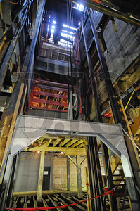 Parts of a freight elevator formerly used to move horses and feed to the building's upper stories will remain in place as design elements.