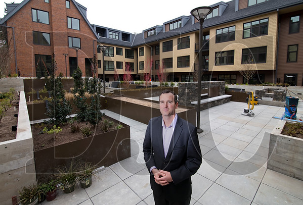PHK Development President Patrick Kessi stands in the central courtyard of The Windward, a three-building mixed-use development in Lake Oswego. (Sam Tenney/DJC)