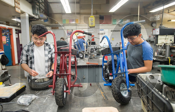 Brothers and Centennial High School students James and Yair Barrera are taking a fabrication and manufacturing course to improve their metalworking skills and build their own minibikes. (Josh Kulla/DJC)