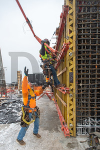 Rafael Bustamantes Cortes, right, a journeyman carpenter with Local 1503 and foreman of the Hoffman Structures Inc. core wall vertical crew, works with fellow HSI employee Bones Ocampo, a journeyman with Local 1977 of Las Vegas, to construct formwork for the core of 5 MLK. (Josh Kulla/DJC)