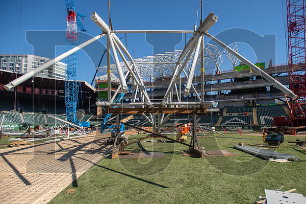 A steel roof truss awaits lifting into place on the playing field at Providence Park.  (Josh Kulla/DJC)