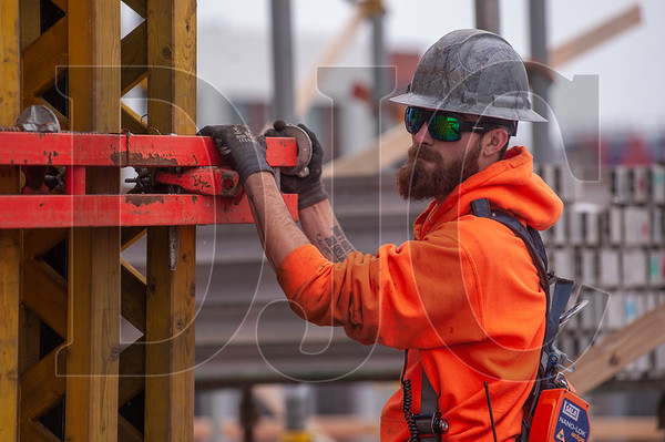 Cameron Ramsey, an apprentice carpenter with Local 1503 and an employee of Hoffman Structures Inc., guides core formwork into place. (Josh Kulla/DJC)